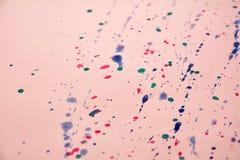 Het bespatten van de daling van de inktkleur Royalty-vrije Stock Afbeeldingen