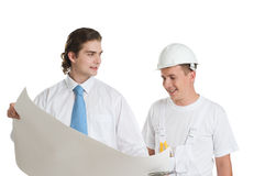 Het bespreken van de ingenieur en van de arbeider Stock Foto's