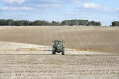 Het Bespuitende Gebied van de tractor stock afbeelding