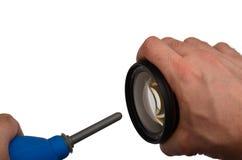 Het bestrooien van dslr lens Stock Foto