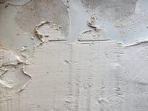 Het betegelen van kleefstof op muur Stock Afbeelding