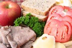 Het bevestigen van de sandwich Stock Foto