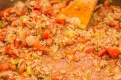 Het bewegen van Spaanse peper in Pot Stock Afbeelding