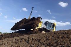 Het bewegende vuil van de bulldozer Royalty-vrije Stock Foto