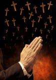 Het bidden en Kruisen royalty-vrije stock foto's