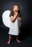 Het bidden engel met handen samen in verering Stock Afbeelding
