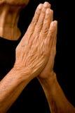 Het bidden handen stock afbeelding
