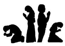 Het bidden silhouetten royalty-vrije illustratie