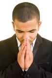 Het bidden van de manager stock afbeelding