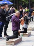 Het bidden van mensen Stock Foto's