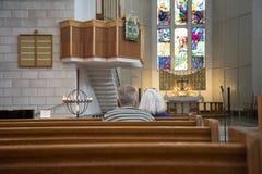 Het bidden van mensen Stock Foto