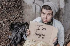 Het bidden voor voedsel Stock Afbeeldingen