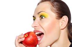 Het bijten van het meisje appel Royalty-vrije Stock Afbeeldingen