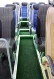 Het binnenland en de zetels van de reisbus stock afbeelding