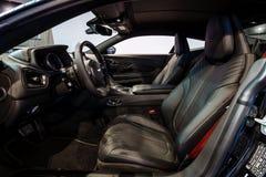 Het binnenland van de grote tourerauto Aston Martin DB11, 2016 Stock Foto's