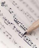 Het blad van de muziek met potlood Stock Foto