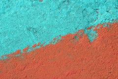 Het blauw en de sinaasappel schilderden concrete muurtextuur Stock Afbeelding