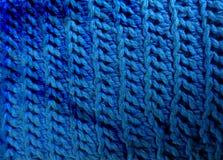 Het blauw haakt achtergrond in katoen stock afbeeldingen