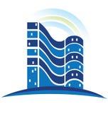 Het blauwe embleem van onroerende goederen Stock Foto's