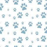 Het blauwe naadloze patroon van de hondvoetstap stock foto's