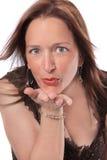 Het blazen van een kus Stock Afbeelding