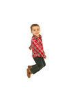 Het blije jongen springen Stock Foto's