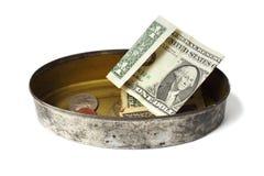 Het blik van het tin met geld Stock Foto