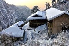 Het blokhuis van de sneeuw coverd Stock Afbeelding