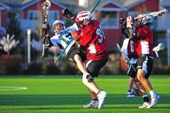 Het blokkeren van de lacrosse stock fotografie