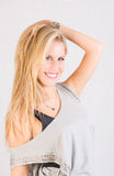 Het blonde yougnvrouw glimlachen Stock Foto