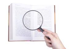 Het boek en de lens Stock Foto's