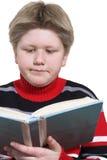Het boek van de de jongenslezing van de blonde Stock Foto