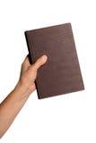 Het Boek van de Holding van de hand Royalty-vrije Stock Foto's