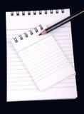 Het boek van de nota met potlood Stock Foto's