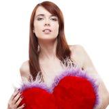 Het bont rood hart van de meisjesholding Stock Foto