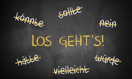 Het bord met gestreken woorden als kon en indien en & x22; Let& x27; s go& x22; Stock Foto