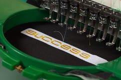 Het borduurwerk van het succes Stock Foto's