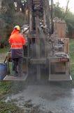 Het boren voor water stock afbeelding