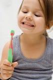 Het borstelen van tanden royalty-vrije stock afbeeldingen