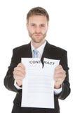 Het boze document van het zakenman tearing contract Royalty-vrije Stock Fotografie