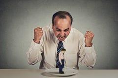 Het boze mens chef- gillen bij bang gemaakte zakenmanwerknemer Stock Foto