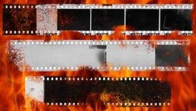 Het branden en beschadigde strook van celluloidfilm royalty-vrije stock fotografie