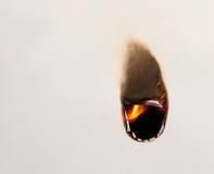 Het branden van het gat in document Stock Foto