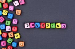 Het brandmerken woord op blauwe achtergrond stock afbeelding