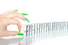 Het breken van de domino's Stock Afbeelding