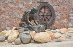Het bronsstandbeeld van de wasmachinevrouw royalty-vrije stock afbeeldingen
