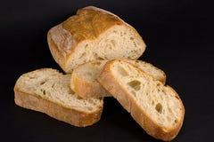 Het brood en de plakken van het brood Stock Afbeeldingen