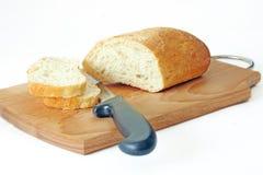 Het brood op de keukenraad Royalty-vrije Stock Foto's