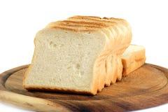 Het brood van de toost op keukenraad Stock Foto
