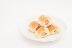 Het brood van de worst Worst in het deeg op witte achtergrond, selectieve nadruk Royalty-vrije Stock Afbeelding